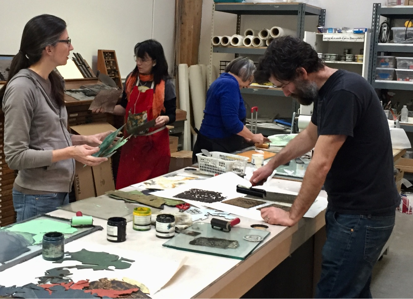Worob printing during a workshop at the Bend Art Center. Image courtesy of the artist.