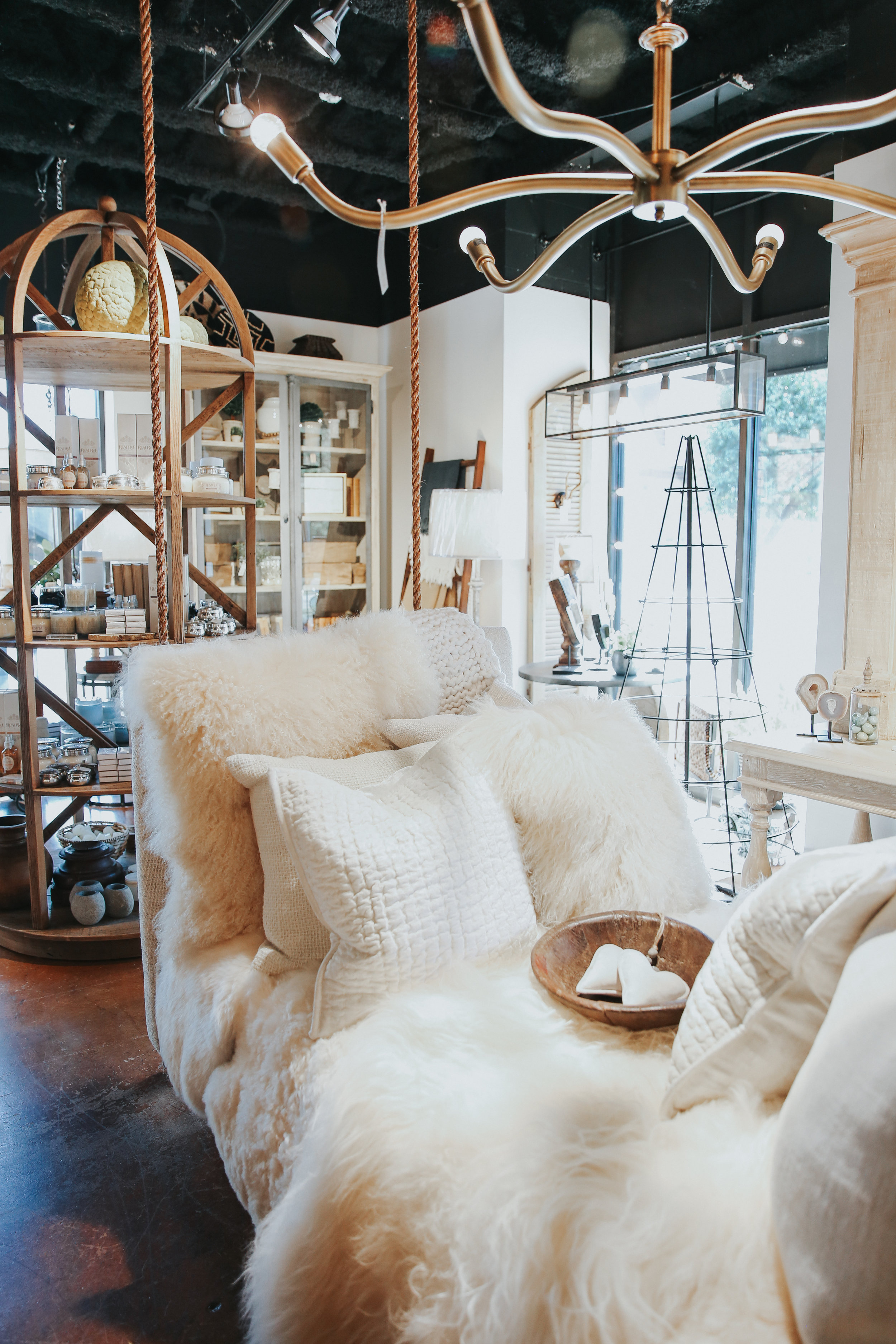 Indoor swing and home decor. Vignette Boutique downstairs.
