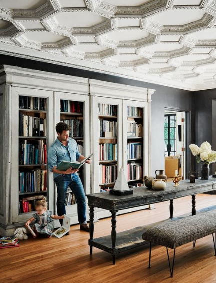 "More books - with the bindings showing! None of that books turned backwards business so you only see white pages, not the titles. Not being able to see the bindings looks a little concocted in our opinion and reeks of ""trying too hard"" design. Nate Berkus (shown here) gets it."