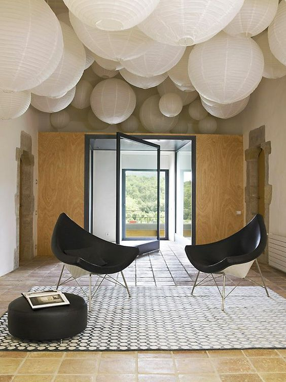 Even paper lanterns can make a fun ceiling and give a beautiful filtered warm light in the space