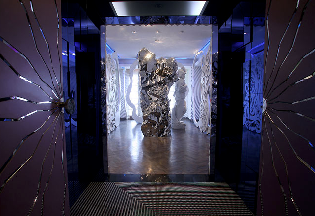 An entrance to the apartment frames Zhan Wang's stainless steel rock sculpture. Credit: Doug Kanter for The New York Times