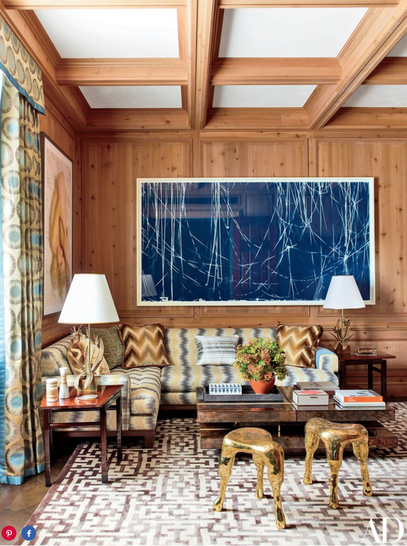 A Christian Marclay cyanotype is installed in the pine-paneled study, where a sectional sofa clad in Stroheim fabric joins Haas Brothers stools and a bespoke rug by Beauvais.
