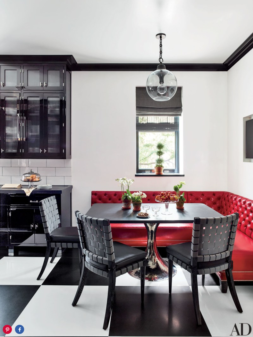 In the breakfast area, a Julian Chichester table base with a granite top is paired with custom-made chairs cushioned in an Osborne & Little fabric.