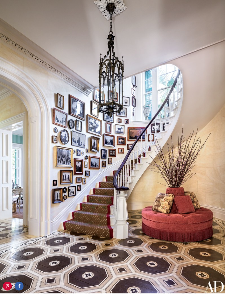 Antique silhouettes hang in the stair hall, which is furnished with a borne covered in a Brunschwig & Fils chenille; the lantern is 19th-century Gothic Revival, the stair runner is by Stark, and Haleh Atabeigi painted the floor.