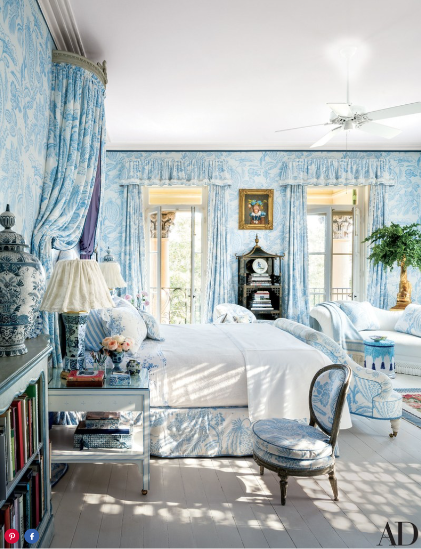 A Manuel Canovas fabric lavishes the master bedroom, where a Donald Roller Wilson painting is displayed above a 19th-century chinoiserie étagère from Philip Colleck.
