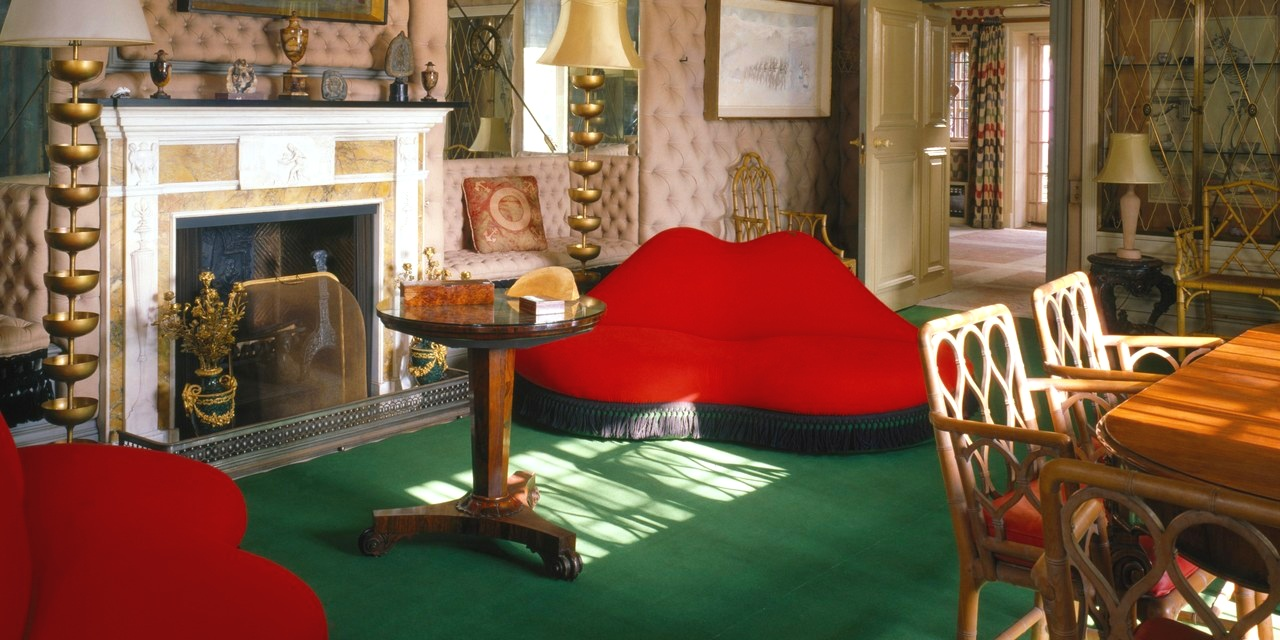 "Salvador Dalí's ""Mae West"" lips sofas at Monkton, the former home of Edward James. Photo by Elizabeth Whiting & Associates / Alamy Stock Photo"