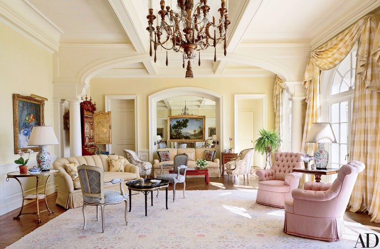 Sofas upholstered in fabrics by Cowtan & Tout (left) and Lee Jofa stand in the living room amid antique accents; the circa-1880 Louis XVI–style bergères are clad in an Old World Weavers floral.