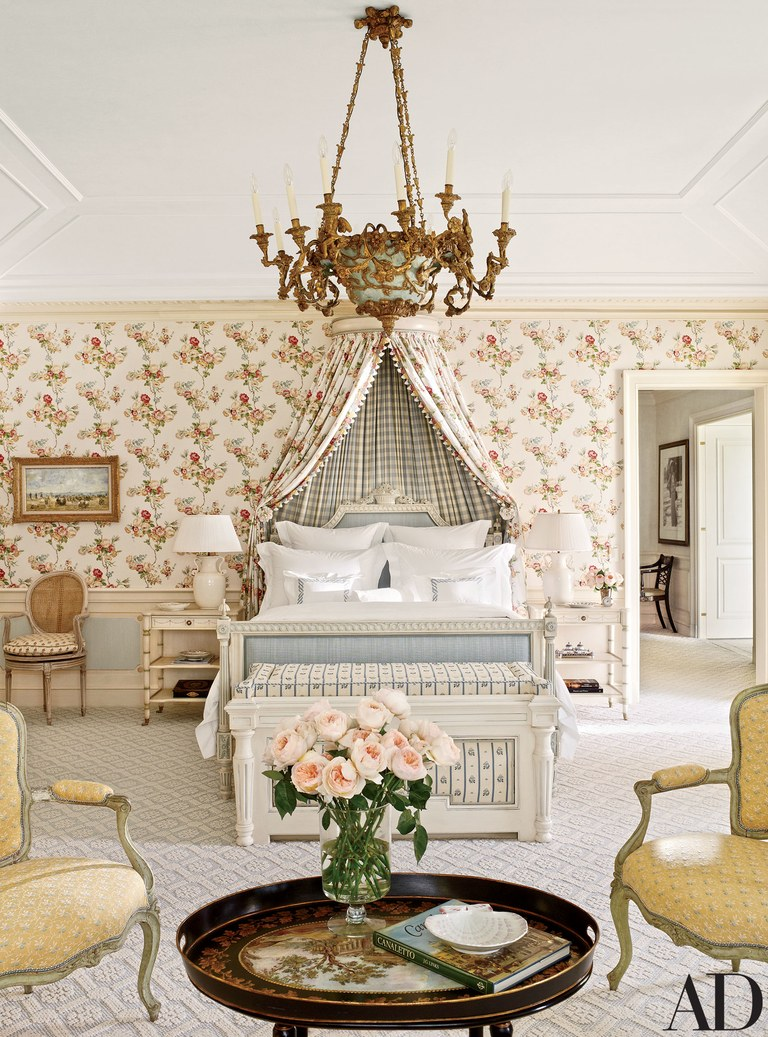 The master bedroom is punctuated by a circa-1790 Piedmontese chandelier from Scott Barnes Antiques; the carpeting is by Patterson Flynn Martin.
