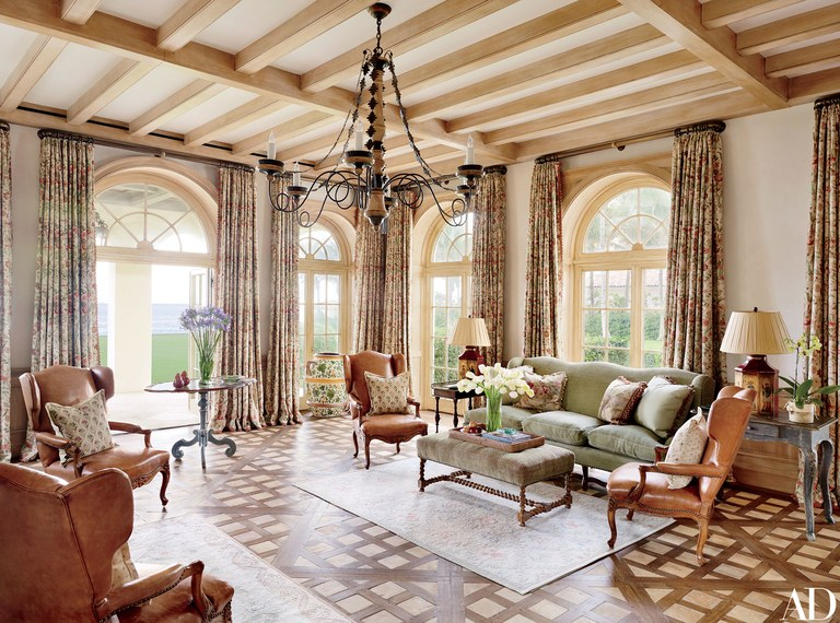 In the family room, a Formations chandelier joins curtains made of a Lee Jofa print.