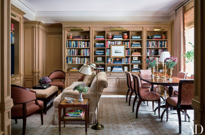 The dining room was reconfigured to include bookshelves and a TV area; a set of Art Deco side chairs from Karl Kemp Antiques in a Pierre Frey fabric surrounds a 19th-century Irish table, and the chairs at left are by Hickory Chair.