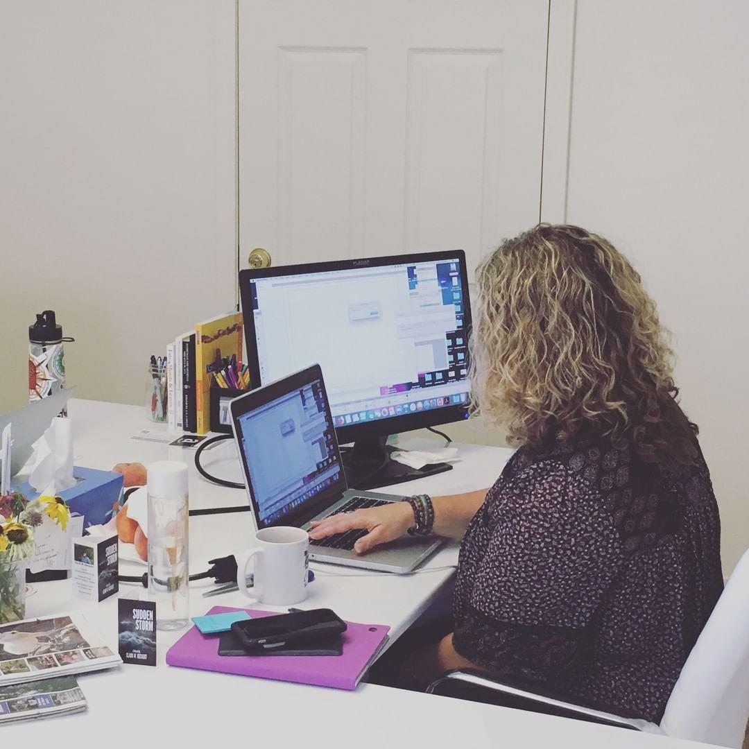 Alyssa Ohnmacht, LOTM's Graphic Designer, working on  Homespun Mercies.