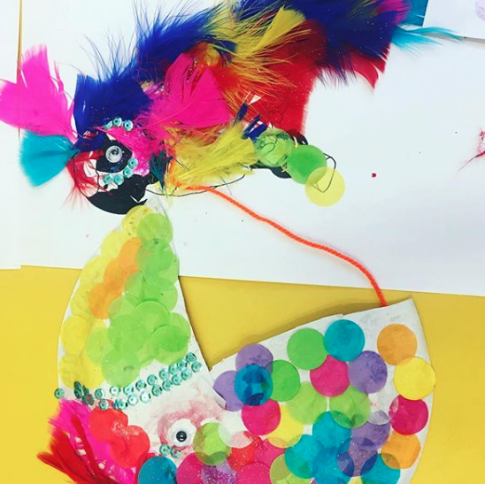 Paper plate parrots and worksheets adorned with glitter and found objects (pirate theme).
