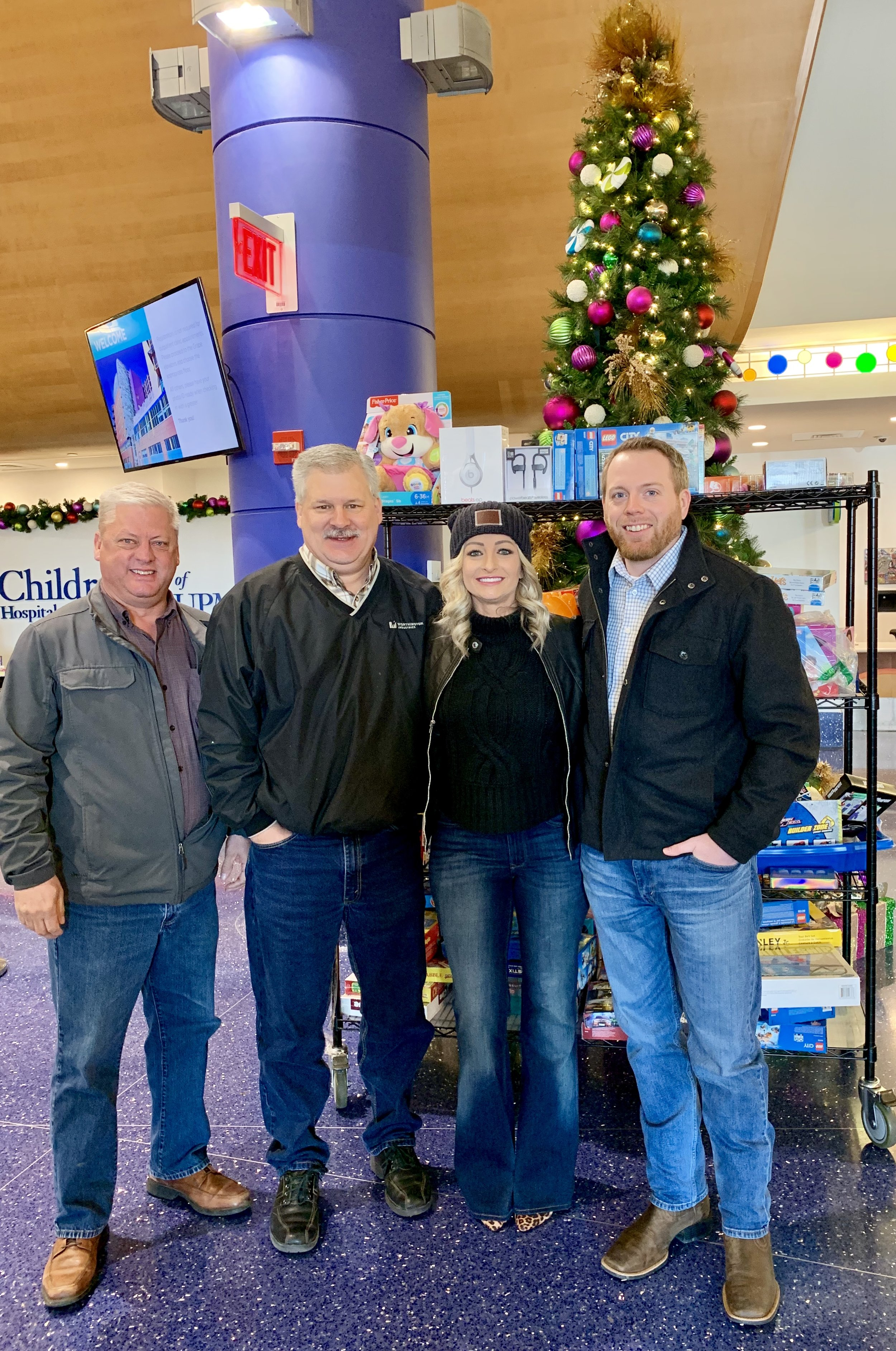 MUG Board Members Walt Elmquist, Todd Householder, Crystal Miller, and Chris LaBarte dropped off toy donations and $2,500 in proceeds raised from the MUG Holiday Happy Hour.