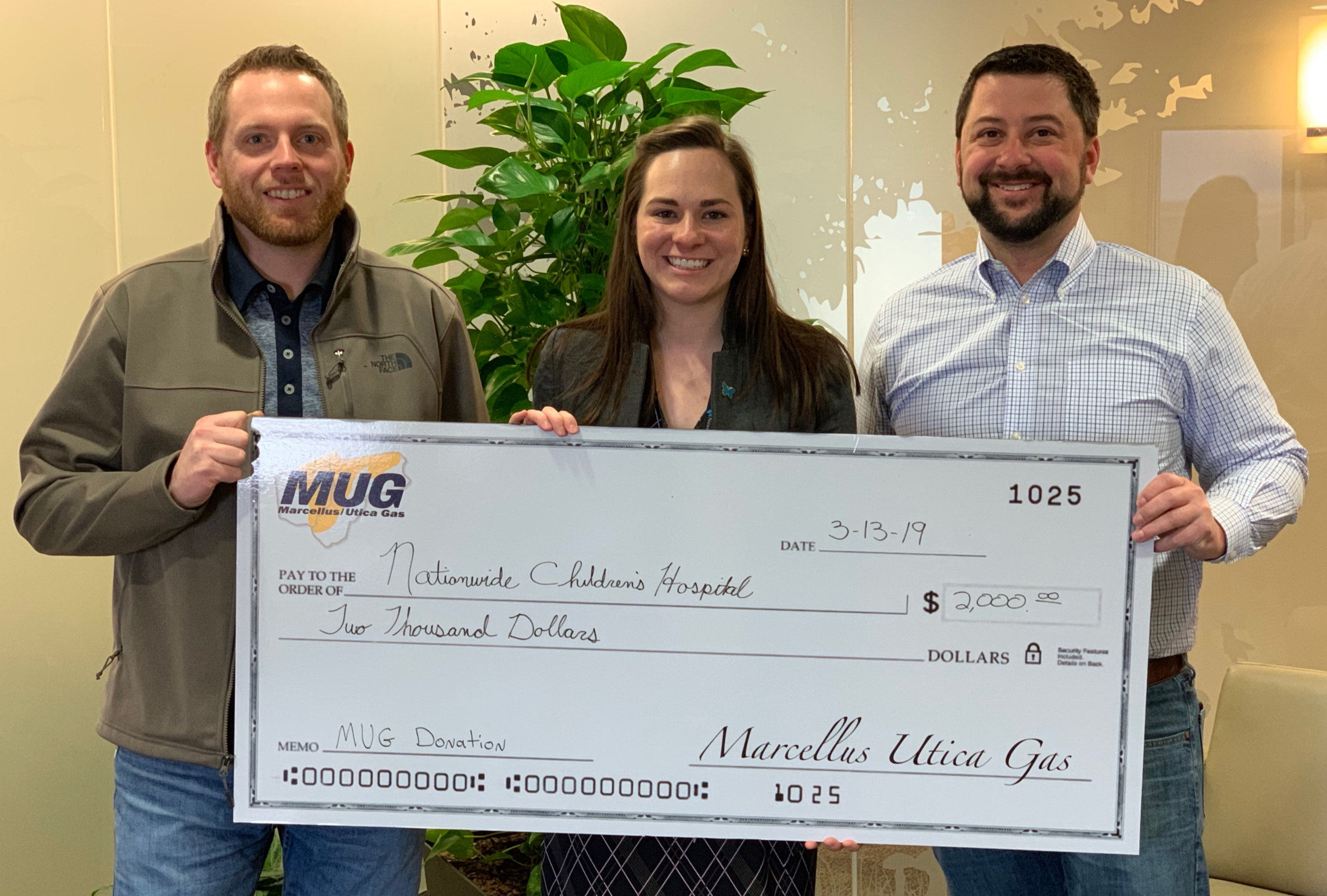 MUG Board Members Chris LaBarte and Zane Johnson present a check to Nationwide Children's Hospital in Columbus, OH.