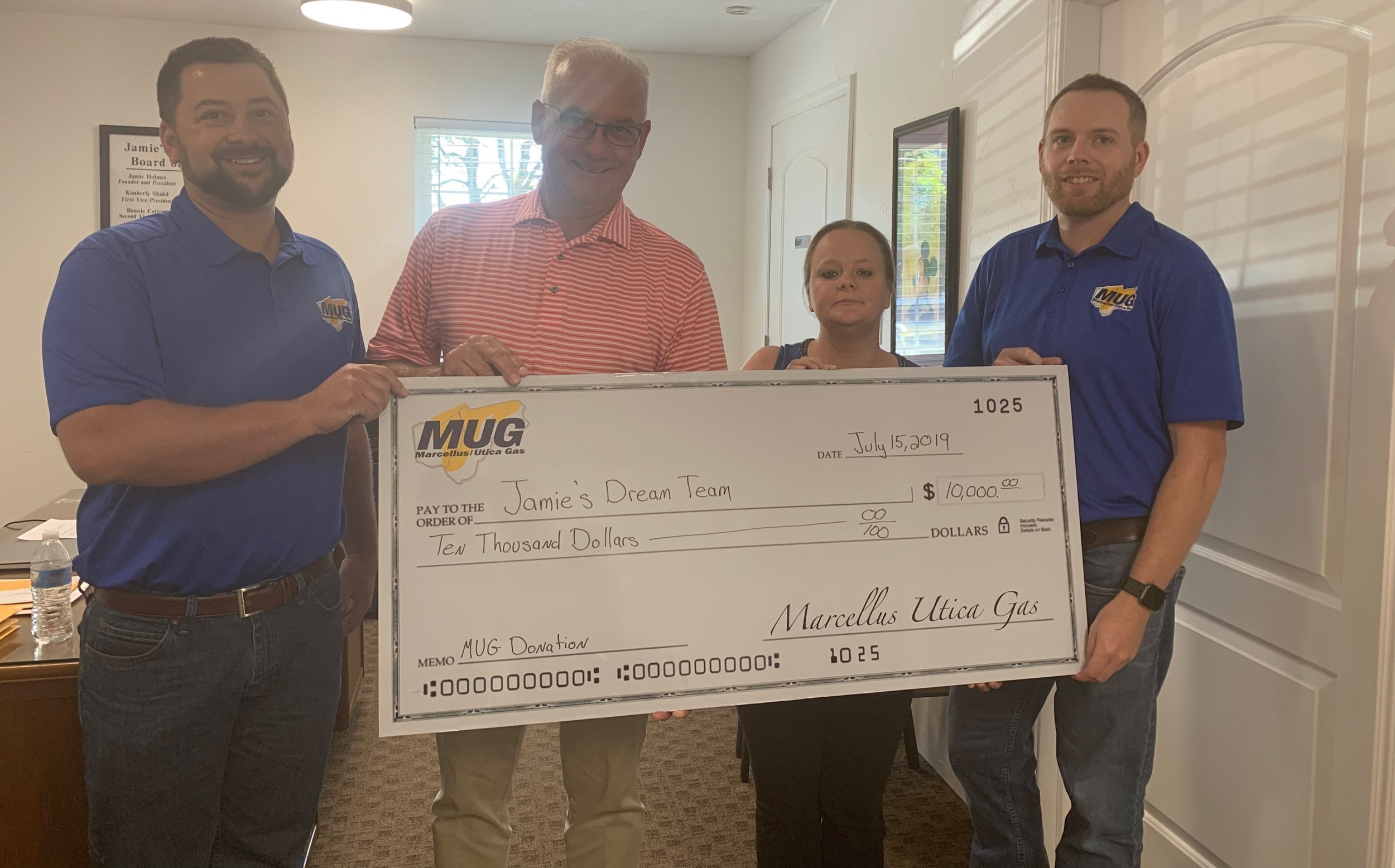 The Marcellus & Utica Gas Suppliers, Services, and Manufacturers Association present a check to Jamie's Dream Team. Pictured left to right: Zane Johnson (Sooner Pipe), Tom Smith (Edgen Murray), Jamie Holmes Ward (Jamie's Dream Team), and Chris LaBarte (US Well Services).