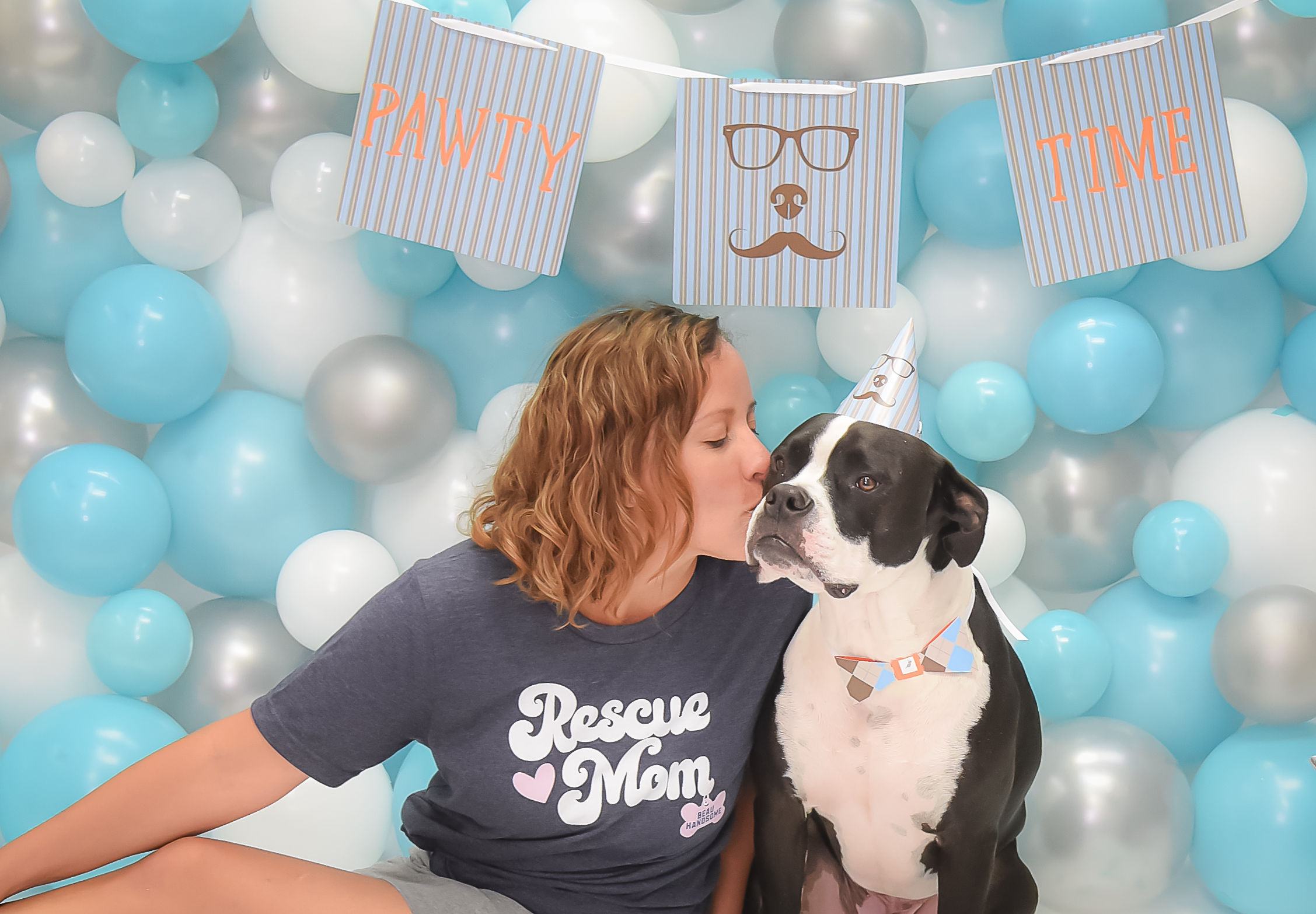 Nouba passed away in 2016, but his legacy lives on as the star of the Pawty in a Box logo. This is Mandy with her new dog, Beau Handsome.
