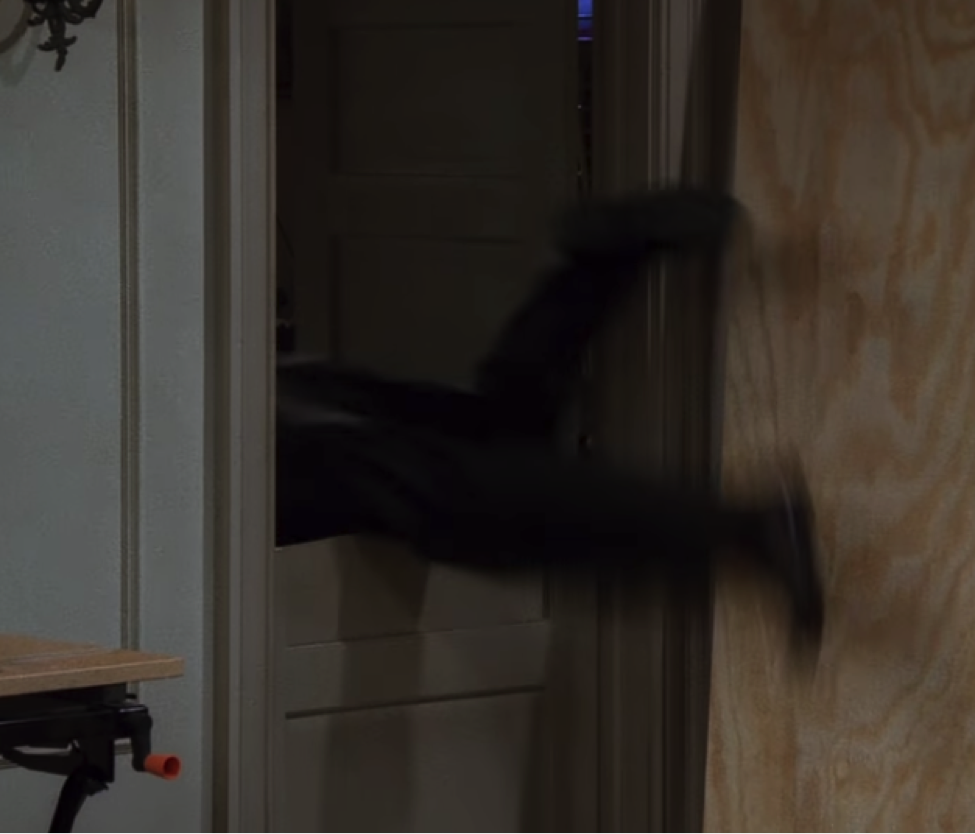 Chandler falls over the second half of his door / NBC Universal / @handbagmarinara