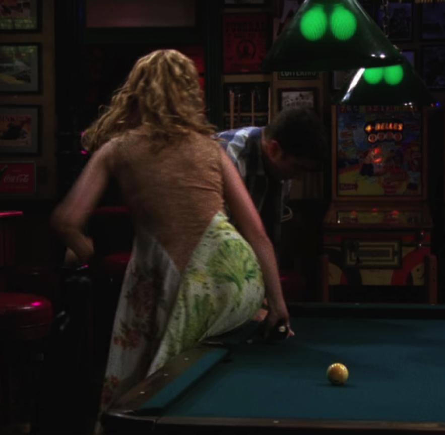 Lisa Kudrow grabbing two billiard balls to set up for the next joke. / NBC Universal / Handbag Marinara / @handbagmarinara