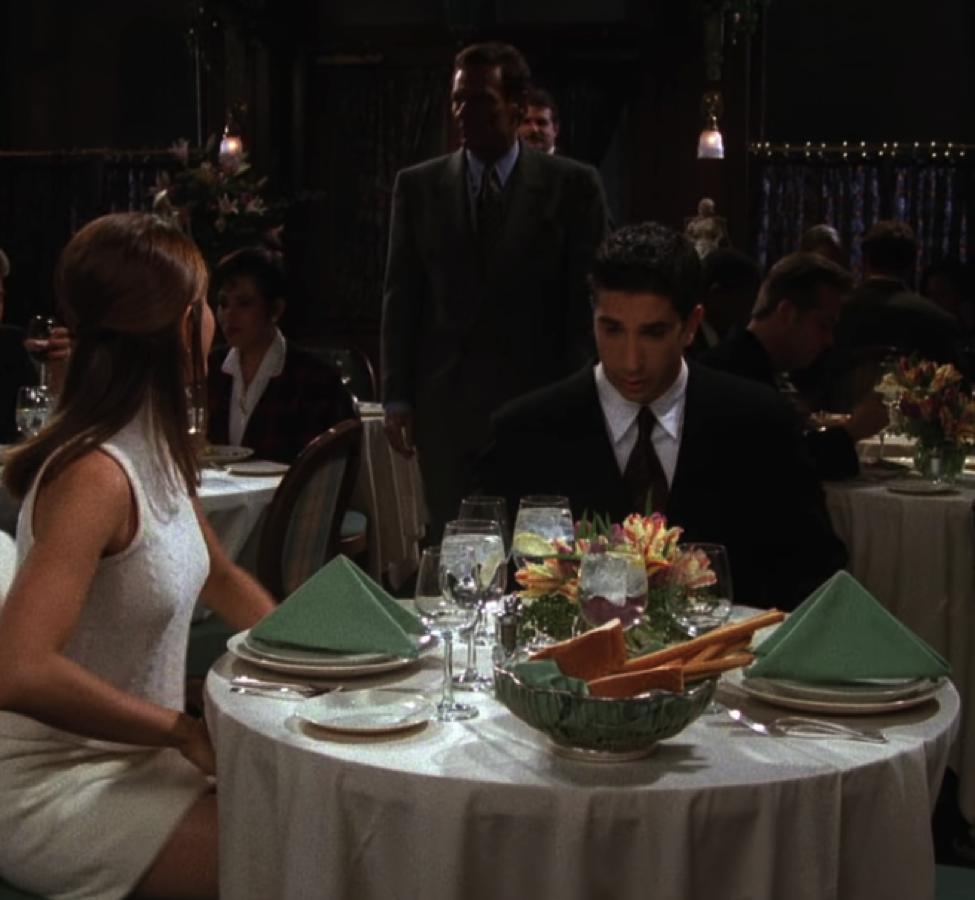 Ross is  not  looking forward to this meal. Or the bread basket. / NBC Universal / Handbag Marinara: A FRIENDS Podcast / @handbagmarinara