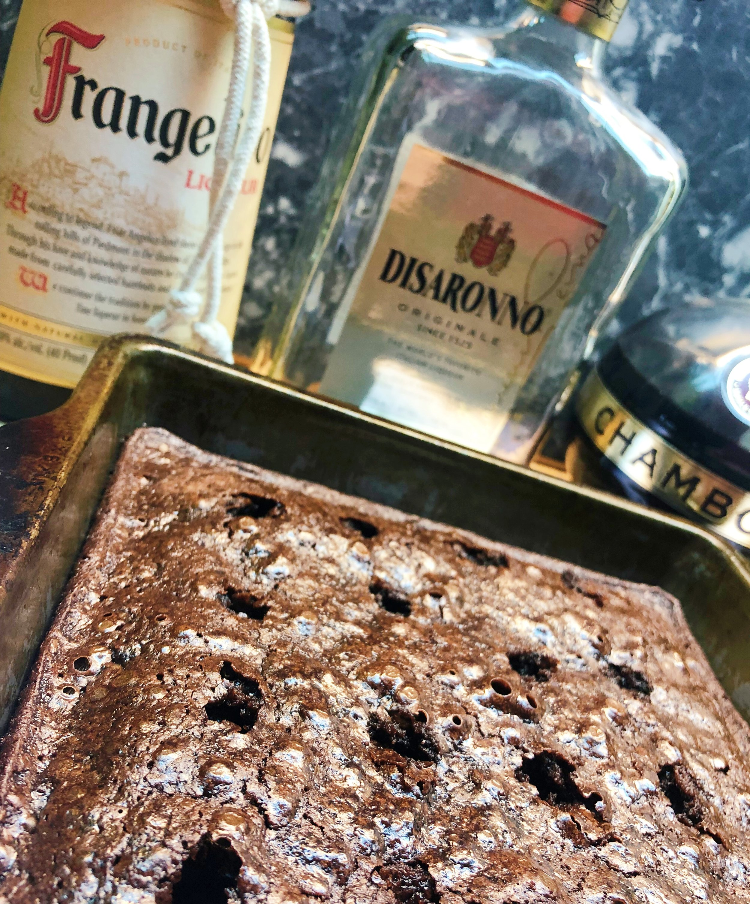 Poke Brownies — a boozy brownie soaked with Disaronno, Chambord, and Frangelico! / Handbag Marinara / @handbagmarinara