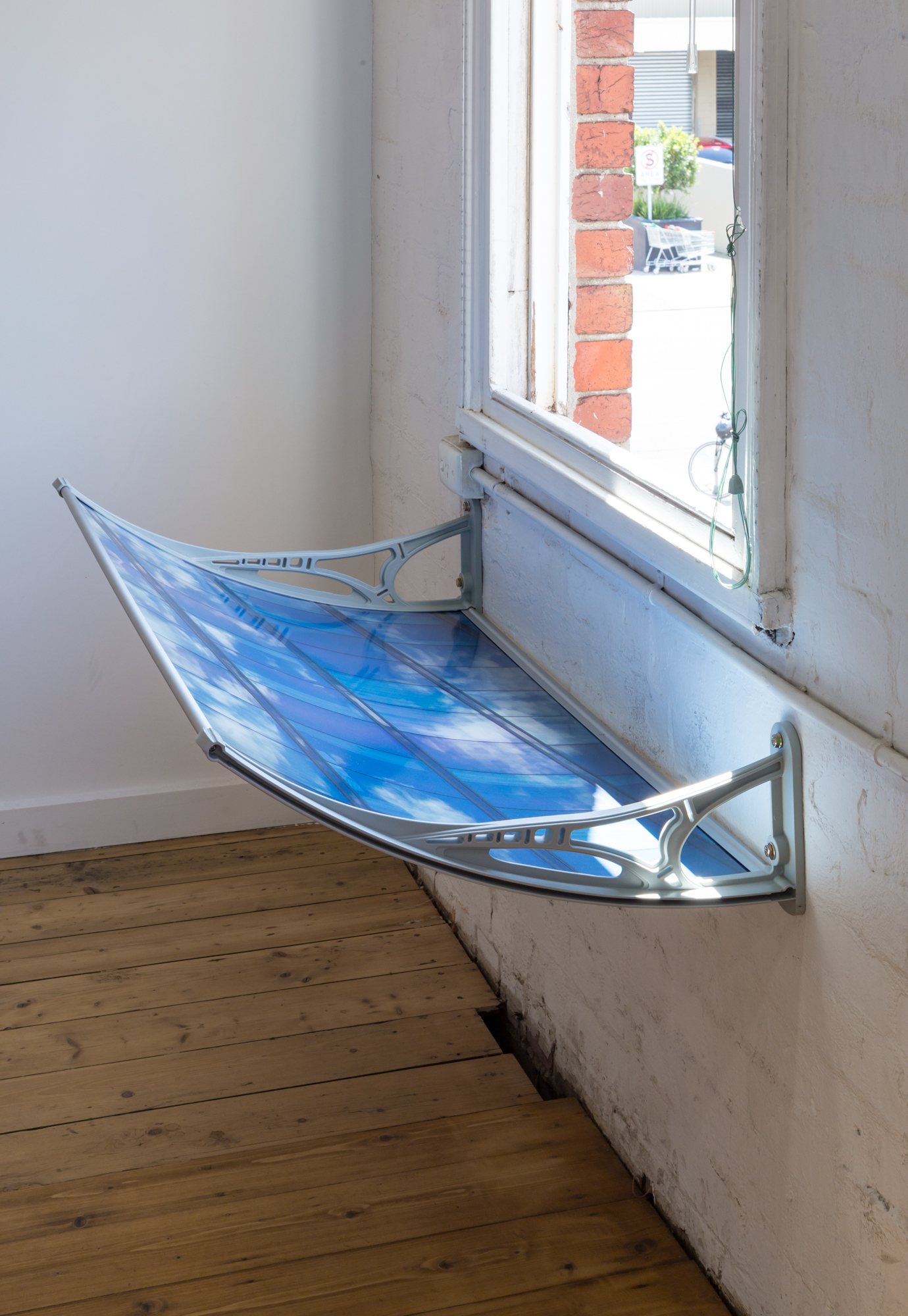 Virginia Overell,  Objective Image , 2017 digital print on metallic paper, polycarbonate canopy photo by André Piguet