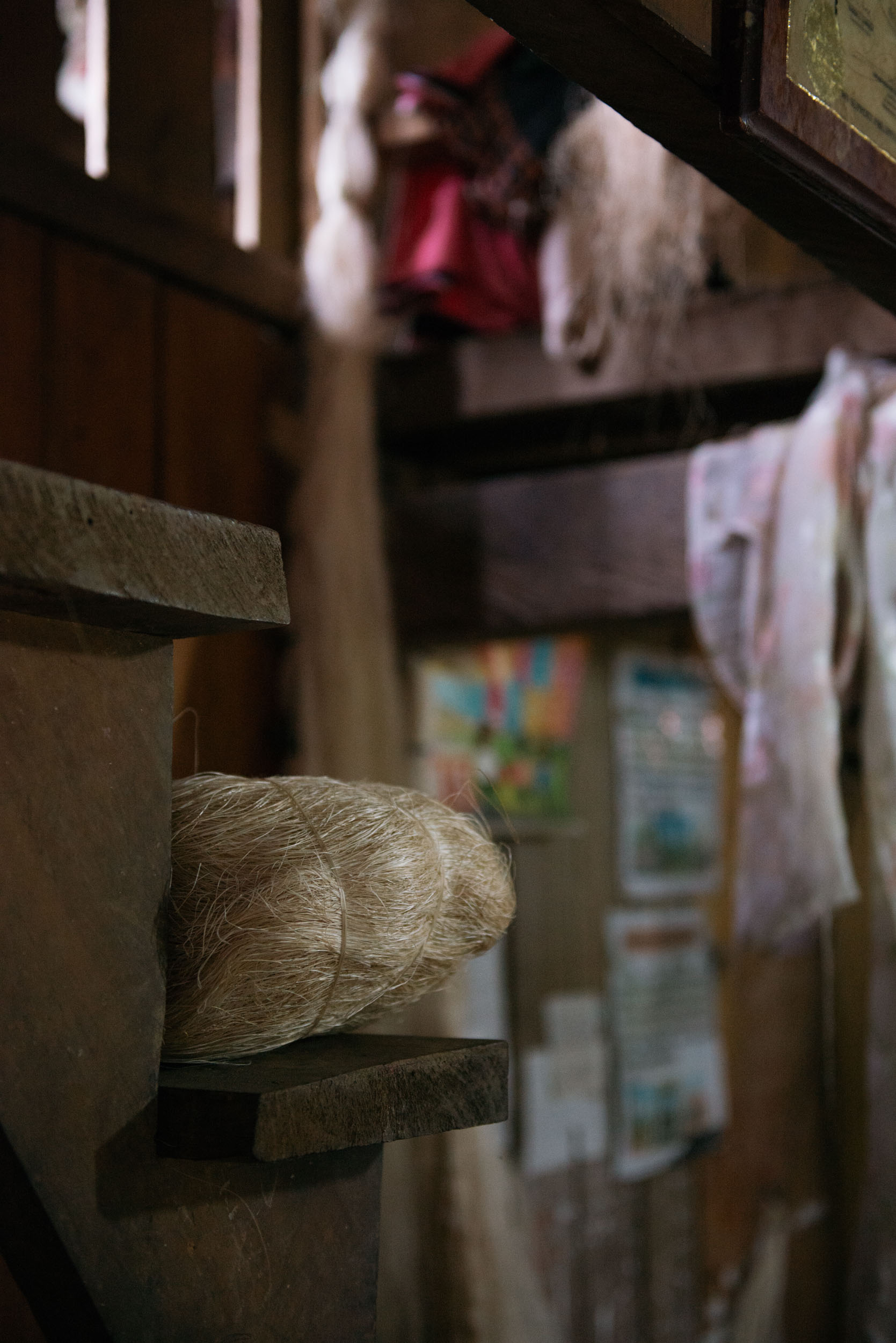 After sun-drying, the fibers are then delivered to the weavers' homes to start the Hinabol making process. The women in every weaving household will start the  lubok  or pounding of fibers in a big wooden mortar and pestle for five consecutive times to make the thread stronger. Pictured above are the fibers bundled together after pounding.