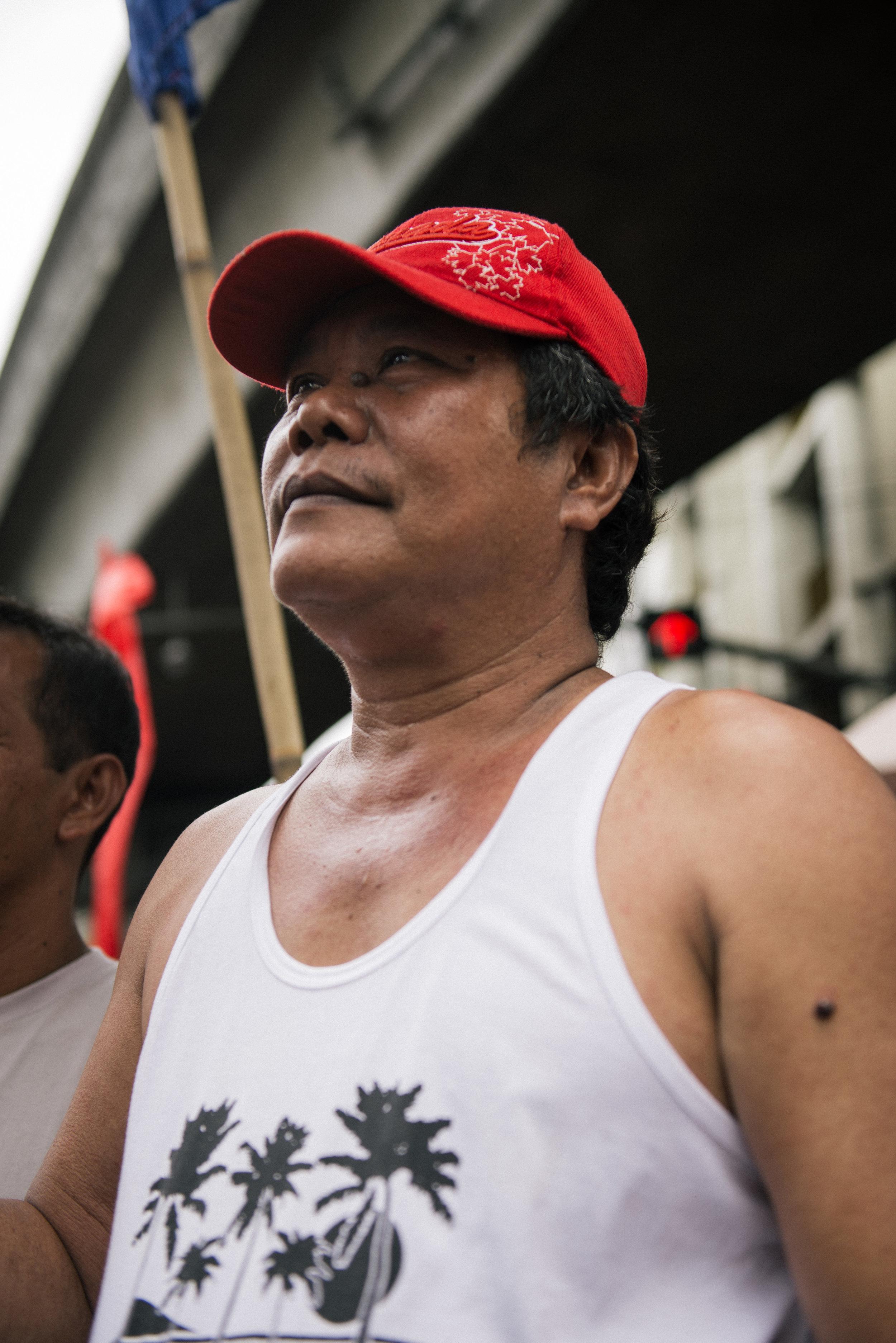 """Celso, 51.   Tatlumpu't tatlong taon nang jeepney driver.  Biyaheng Guadalupe – Guinto.    """"Pagmamaneho ng dyip ang bumuhay sa pamilya ko ngunit nitong bandang huli, medyo magulo at mawawalan kami ng pang-hanapbuhay katulad ng inuubos na ang mga luma at gagawing bago ang sasakyan. Tapos 35 edad pataas ay hindi na raw puwedeng magmaneho. Paano na kaming 50+ na, malakas pa maghanapbuhay, malakas pa magmaneho? Hindi na pala kami pwedeng maghanapbuhay?""""    """"Malaki ang epekto sa amin ng jeepney phase-out. Tulad ng ginagawa ng LTFRB ngayon, walang nagsisibyahe dahil takot mahuli. Sasabihin nila dalawang taon, pero yung dalawang taon ipaubaya nalang sana sa aming mga drayber at wag na kami patubusin nang malaki dahil Pilipino rin naman sila at naiintindihan nila ang kahirapan namin dito."""""""