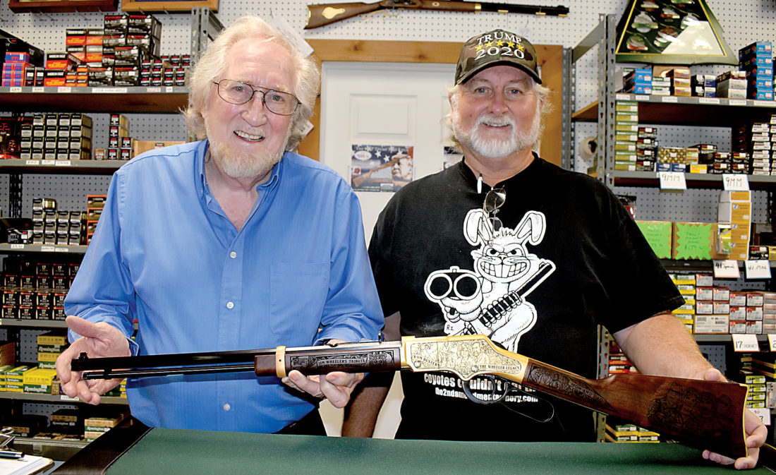 Jim Wheeler, owner of Wheeler's Guns and Ammo, accepts his custom designed Henry Golden Boy .22LR from Steve Faler[right], owner of Heroes and Patriots, LLC  Photo Credit:The Inter-Mountain by Tim MacVean