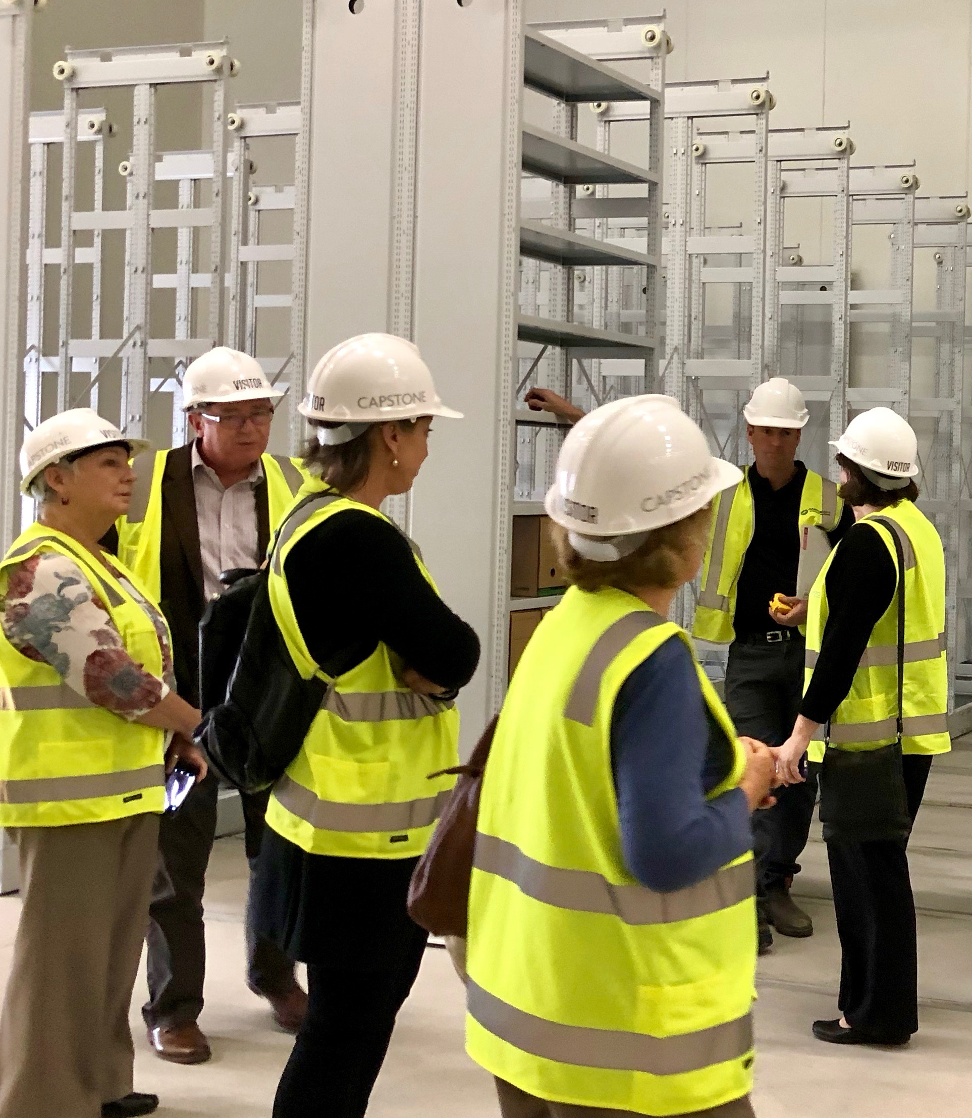 Members of the National Archives Perth Consultative Forum inspecting the new Belmont Repository, with Austrian compactuses used in the Louvre and other major European institutions being installed here — a first in Australia. Note Diane Foster (WAGs), Gerard Foley (SRO) and Helen Munt (PHA and HC) on the left