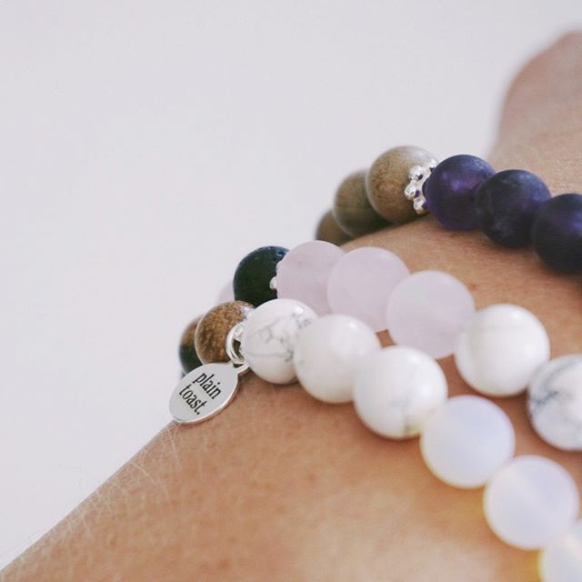 Stacking up - If I cant decide on one I like to stack up these. And mix up the essential oils on each top to create a blend of fragrance to waft in throughout the day :) CALM with amethyst and blue lace agate always feels reassuring to wear and to have close by, and of course our LOVE with rose quartz is just that general all round comforting stone that exudes passion and compassion. I also like to wear CLARITY for its Howlite and Opalite that clears my mind. How do you stack yours? . . #handmadejewellery #intentionjewellery #beads #malabeads #mindful #intention #brand #jewellery #smallbusiness #semipreciousstones #craft #healingcrystals #crystals #crystaljewellery #slowliving #lifestyle #crystalhealing #reiki #yogajewellery #yogi #bohemianaccessories #accessories #bracelets #mala #meditation #oceaninspired #plaintoast #rosequartz #amethyst #howlite