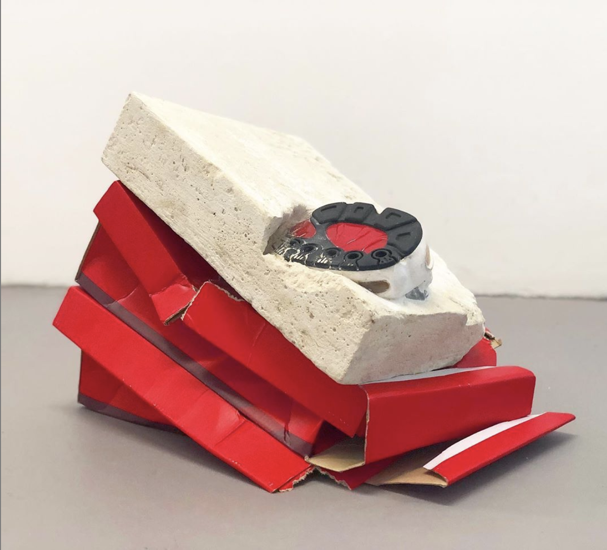 Richie Culver - Latest Works - Dear John.  Cement, sports shoe, cardboard and acrylic  Dimensions variable  2019