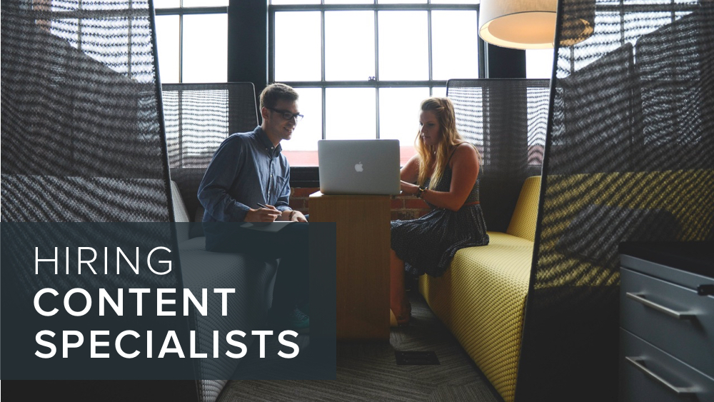 'hiring+content+specialists'+over+image+of+people+discussing+computers.jpg