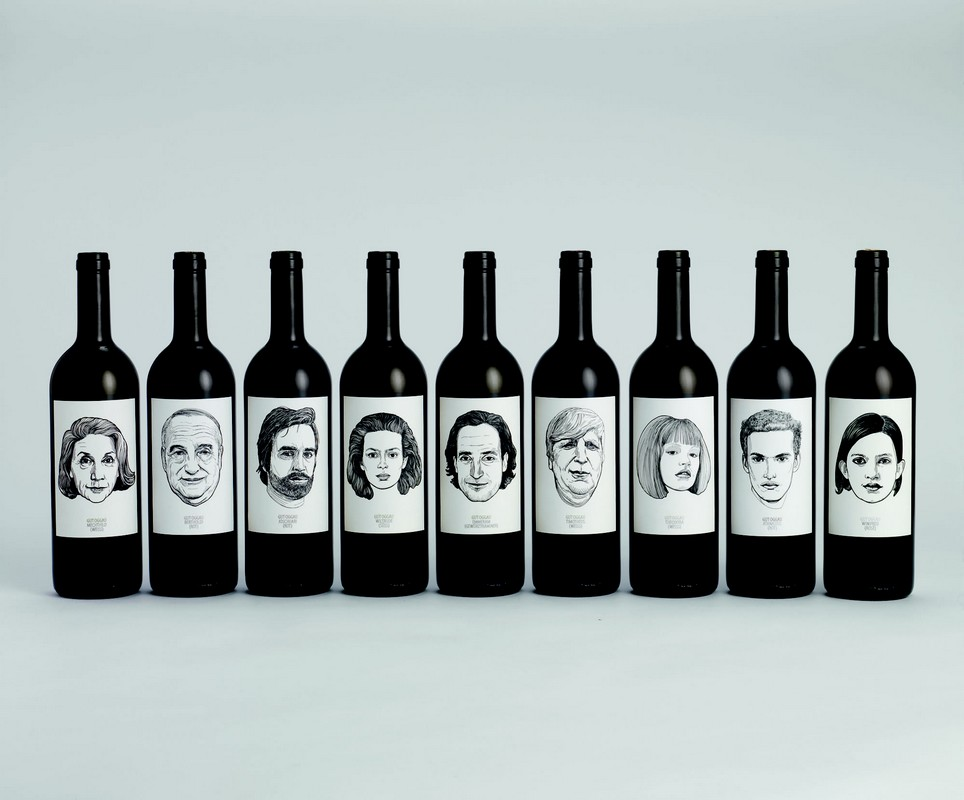Row of wine bottles with illustrated faces on the labels