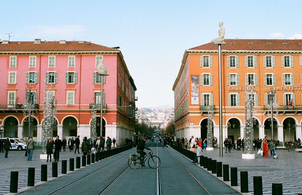 Colourful buildings and cyclist in Nice, France