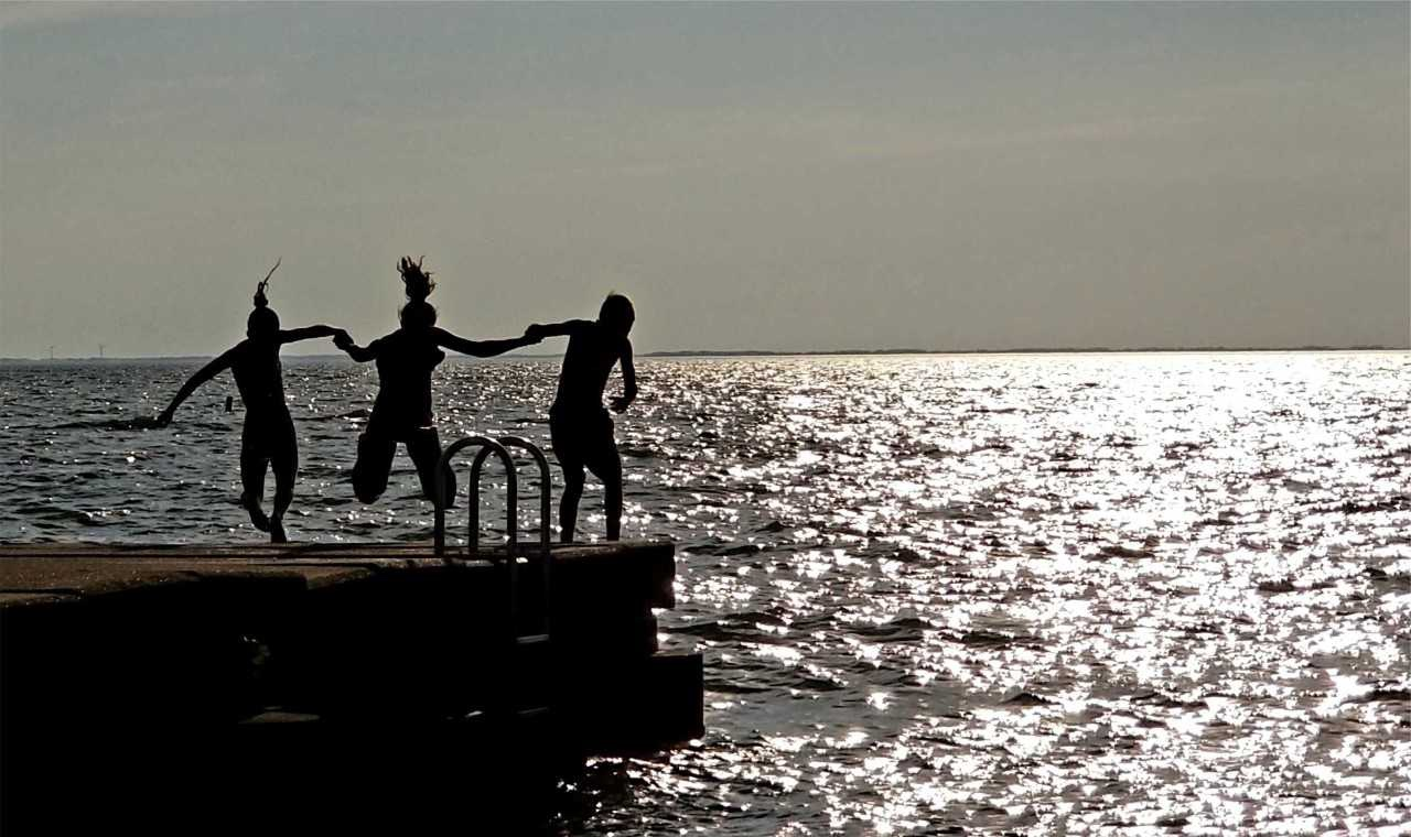 Kids off pier at sunset.jpg