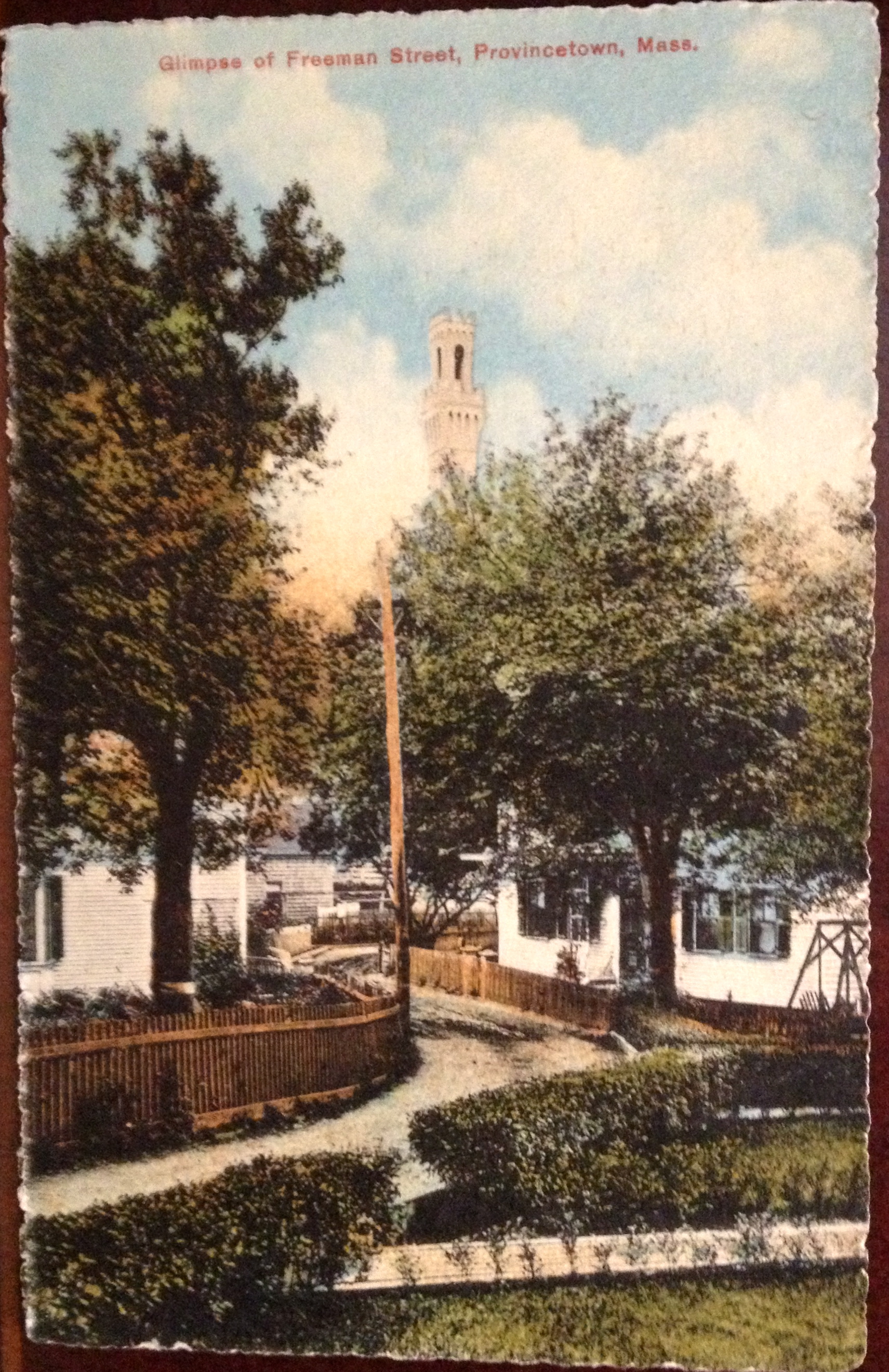 Freeman Street, Provincetown with the Pilgrim Monument in the background. Postcard circa 1900.