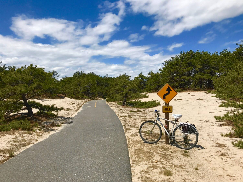 Seashore Bike Adventure - Curve Ahead Sign on the Province Lands Bike Trail - Pedal Ptown Bike Tours.jpg