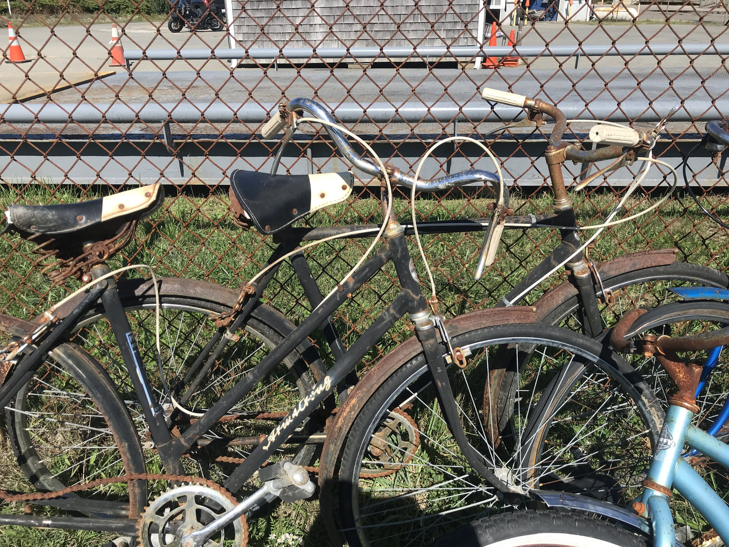 A matching pair of rusty vintage 1960s Armstrong 3-speed bikes at the Provincetown dump.