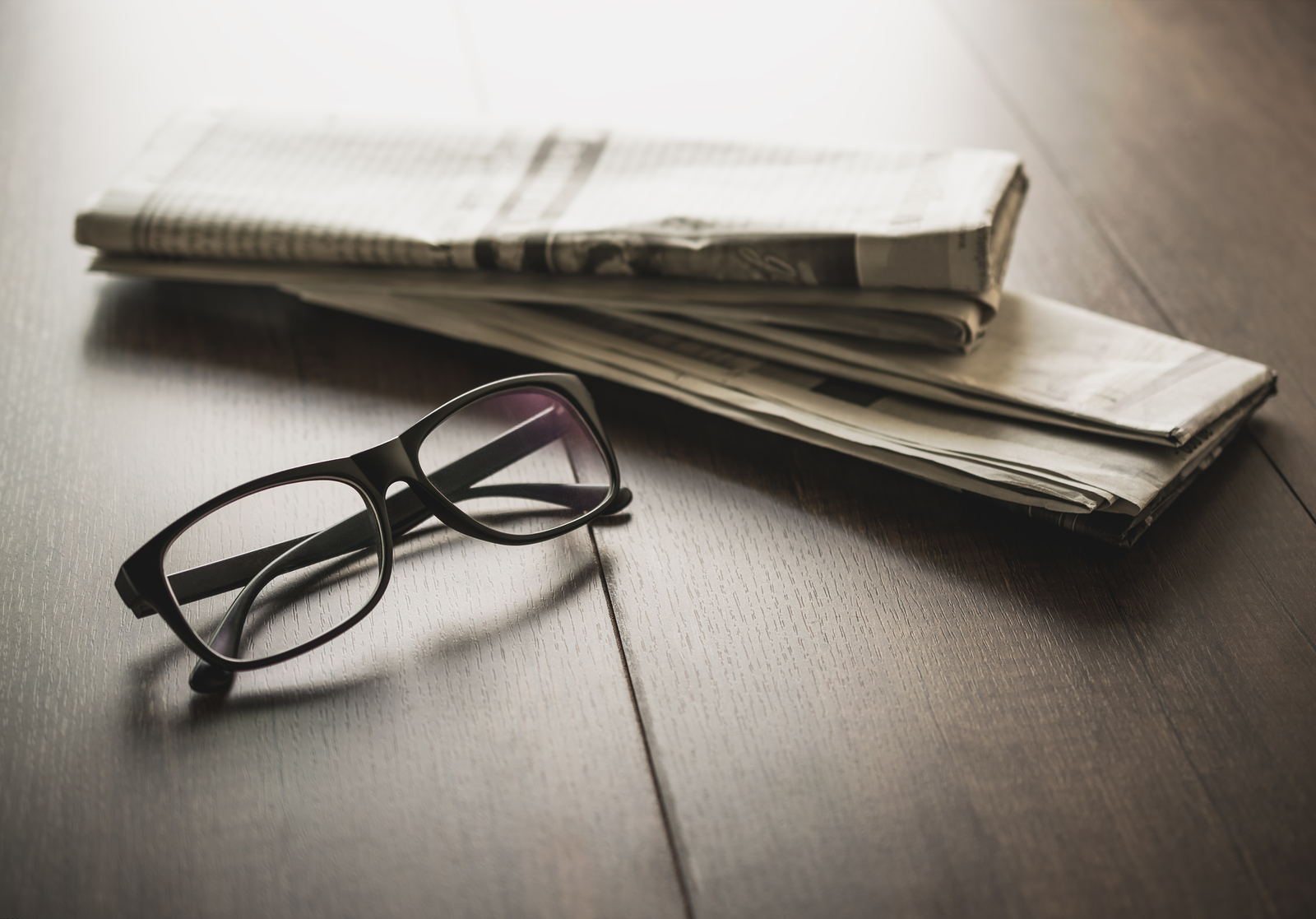 bigstock-Newspaper-And-Reading-Glasses--160153082.jpg