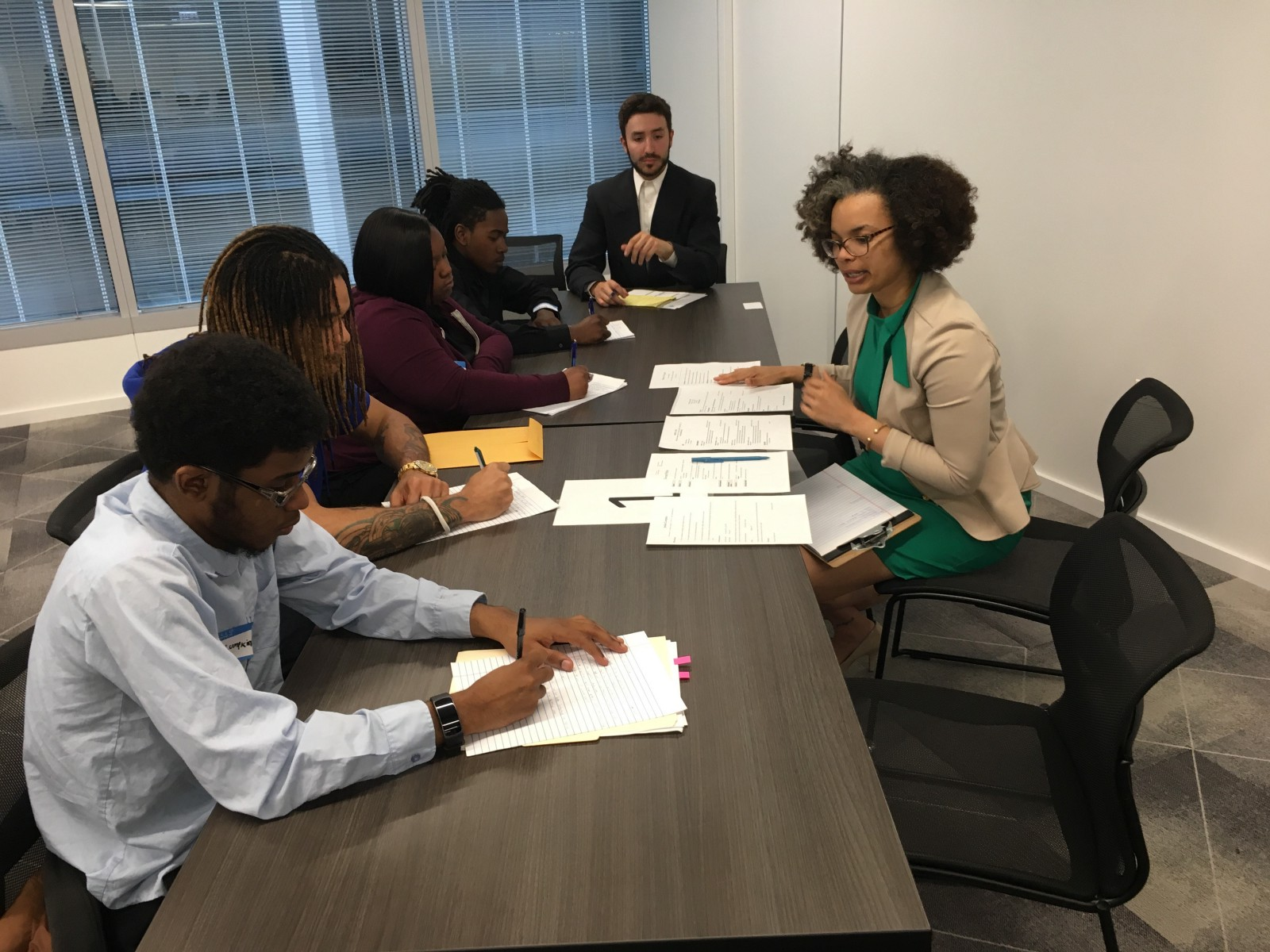 Skills for Chicagoland's Future employees work on interview training.
