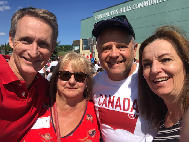 Familiar faces at MP Michelle Rempel's Canada Day BBQ: MP Len Webber and Cynthia Williams enjoying the beautiful day with Ruth and me.