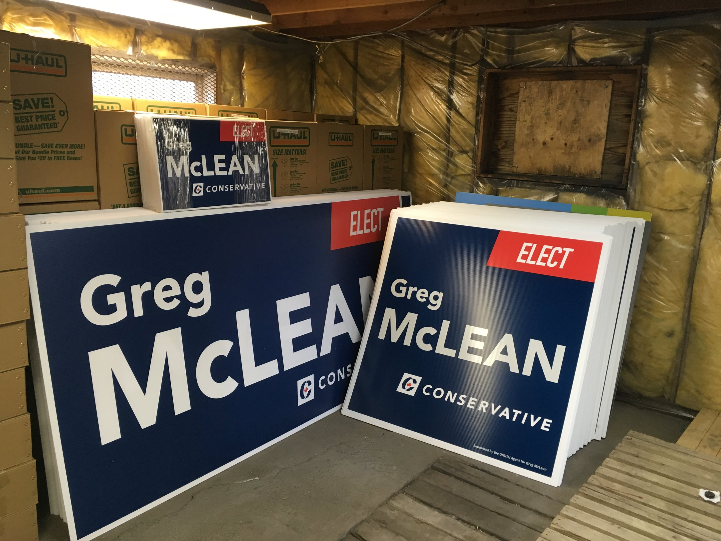 It's starting to get real. Here's our sign order delivered today and in our HQ basement, ready for assembly and delivery in the next couple of weeks.