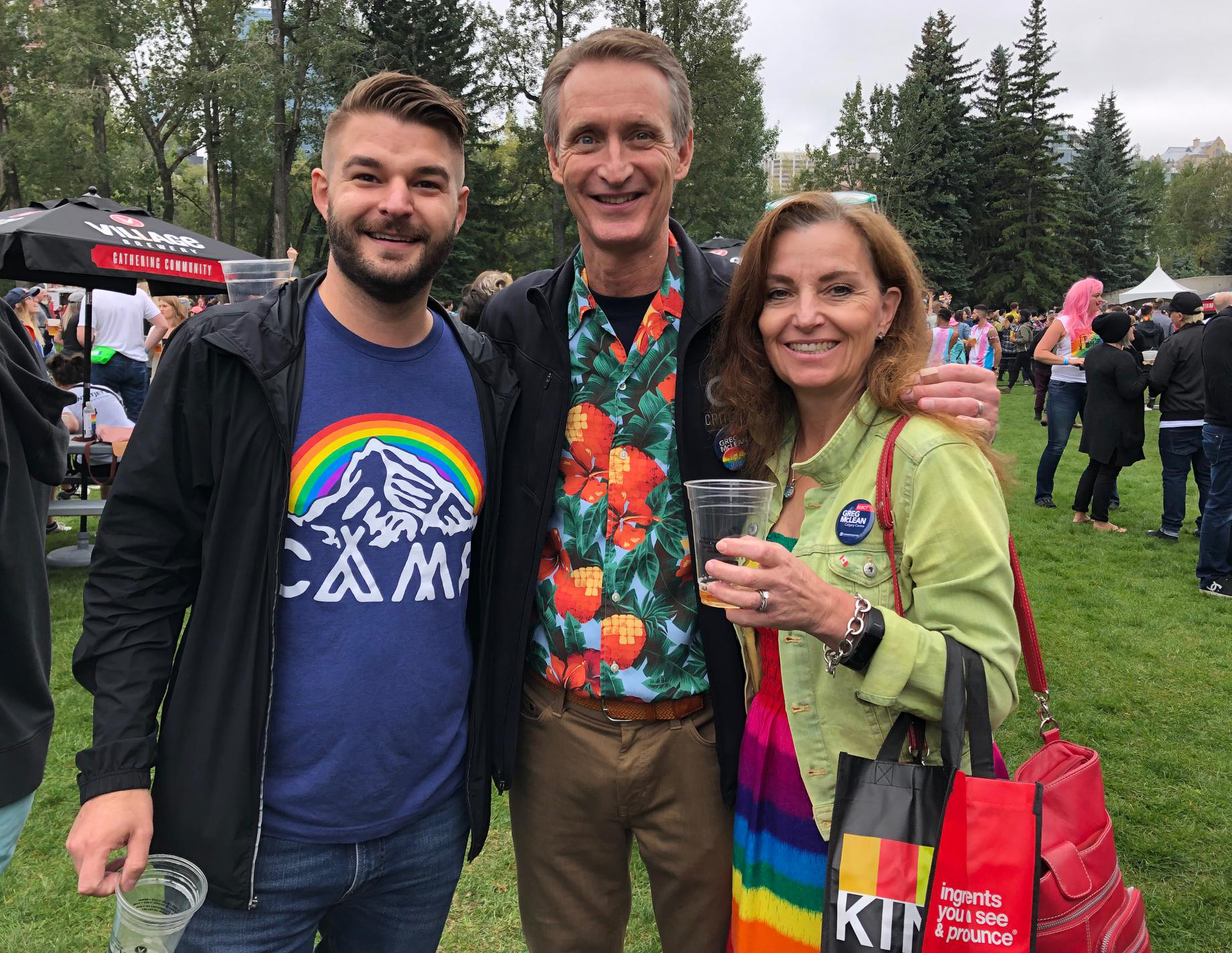 Pride Parade Day isn't complete without a stop at the beer gardens. Ruth and I are pictured with Chris Adams.