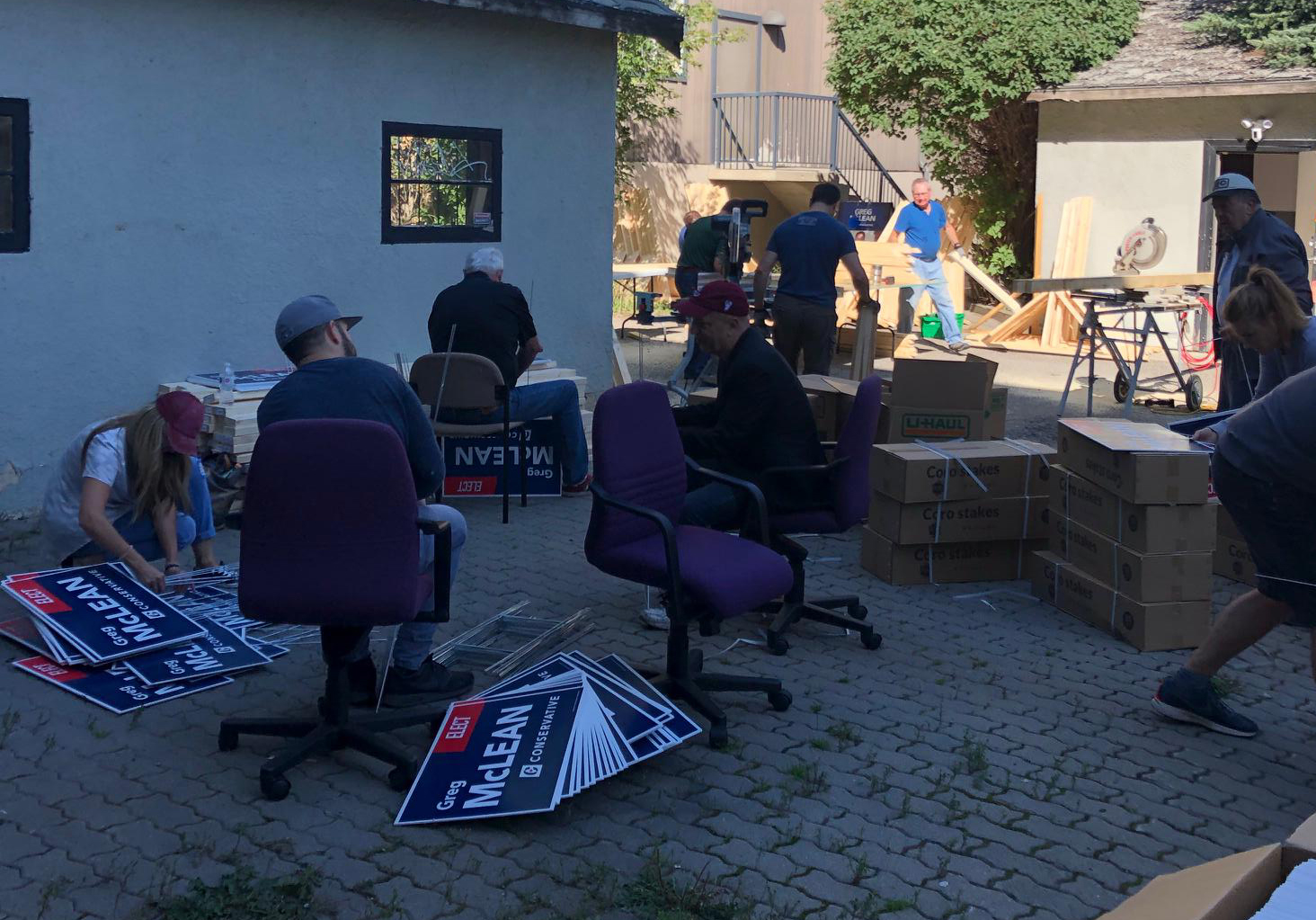 Out back of the campaign HQ, the sign crew is busy assembling the lawn signs for delivery and pickup (Sat Sept 7).