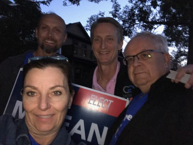 Multi-tasking with signs and knocking doors in Sunalta on Friday the 13th. And finishing up with less sunlight than we are used to!