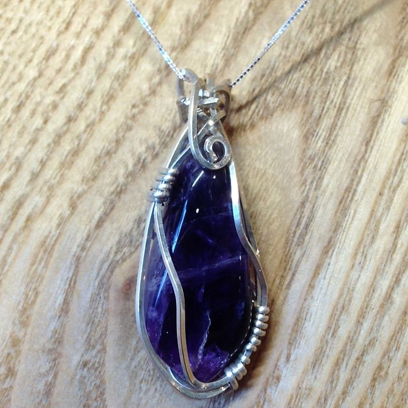 Wire Wrapped Pendant - Wear one of Nature's beautiful stones, wire-wrapped by you! Join Joyce in this 2-hour workshop to learn how to wrap stones in wire, yet still let their natural beauty show through. You will learn to band wire, secure the stone and use basic tools to create a finished pendant. (chain/cord not included) Ages 11+Includes: Wire, tool usage and stone. If you have a special stone you would like to use, feel free to bring it. If you have the basic tools (flush cutters, chain nose pliers and round nose pliers), please bring them too.Instructor: Joyce, The Rockin' ManiacWorkshop fee: $30 per person, minimum 3, maximum 6