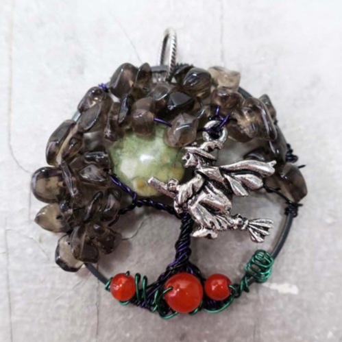 Seasonal Halloween Tree Pendant - Celebrate this spooky time of year by creating a Halloween Tree pendant! In this workshop, you will learn to create your own tree pendant by bending and twisting wire. Different types of stone beads will be available to pick from, that will be added to the wire to create the leaves of your tree, as well as flying witch charm, flat coin shaped beads to add a full moon and round orange beads to create a pumpkin patch. Each type of stone has it's own meaning and purpose. Pick one or more types that speaks to you. A stone guide will be provided. Ages: AdultAll supplies are included. You will leave the class with a completed wire wrapped tree pendant.Instructor: Christina DavisWorkshop fee: $48 per person, minimum 5, maximum 12