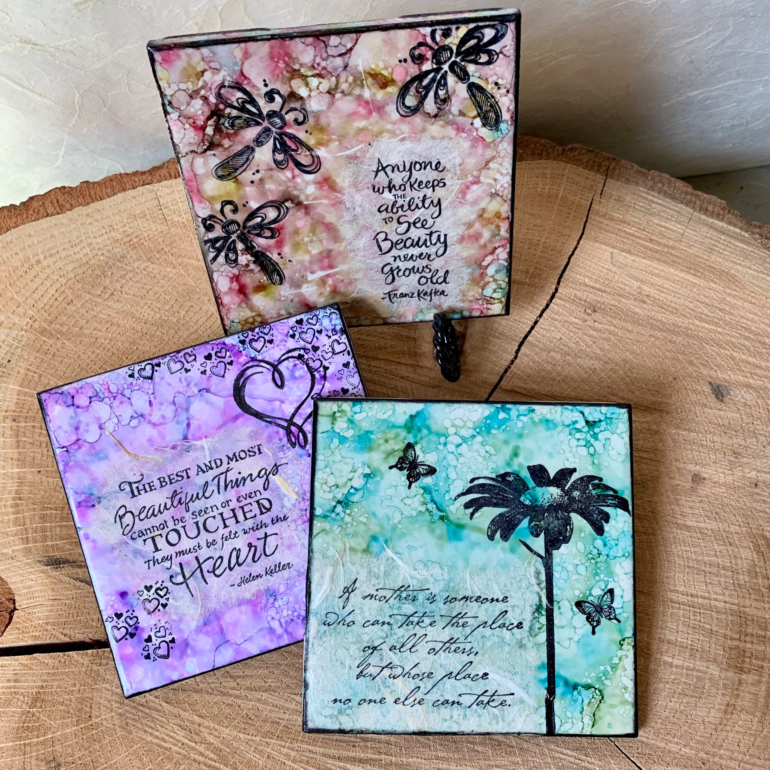 "Inspirational Tiles - Choose your Theme! - In this 2 hour workshop, play with alcohol inks in many color choices to make a colorful background, then use specialty papers, ink and rubber stamps to complete your 4""x 4"" inspirational tile. The workshop will offer several sayings and images related to your chosen theme. Ages: Adult or 10+ with AdultChoose your theme: Garden (flowers, butterflies, dragonflies), Angels, Seasonal, Wildlife, Lighthouses, Nature Scenes, Celestial.All supplies provided, including hanger or easel to display your tile.Instructor: Lisa JarrellWorkshop Fee: $20 or make 2 tiles for $35, minimum 4, maximum 8"