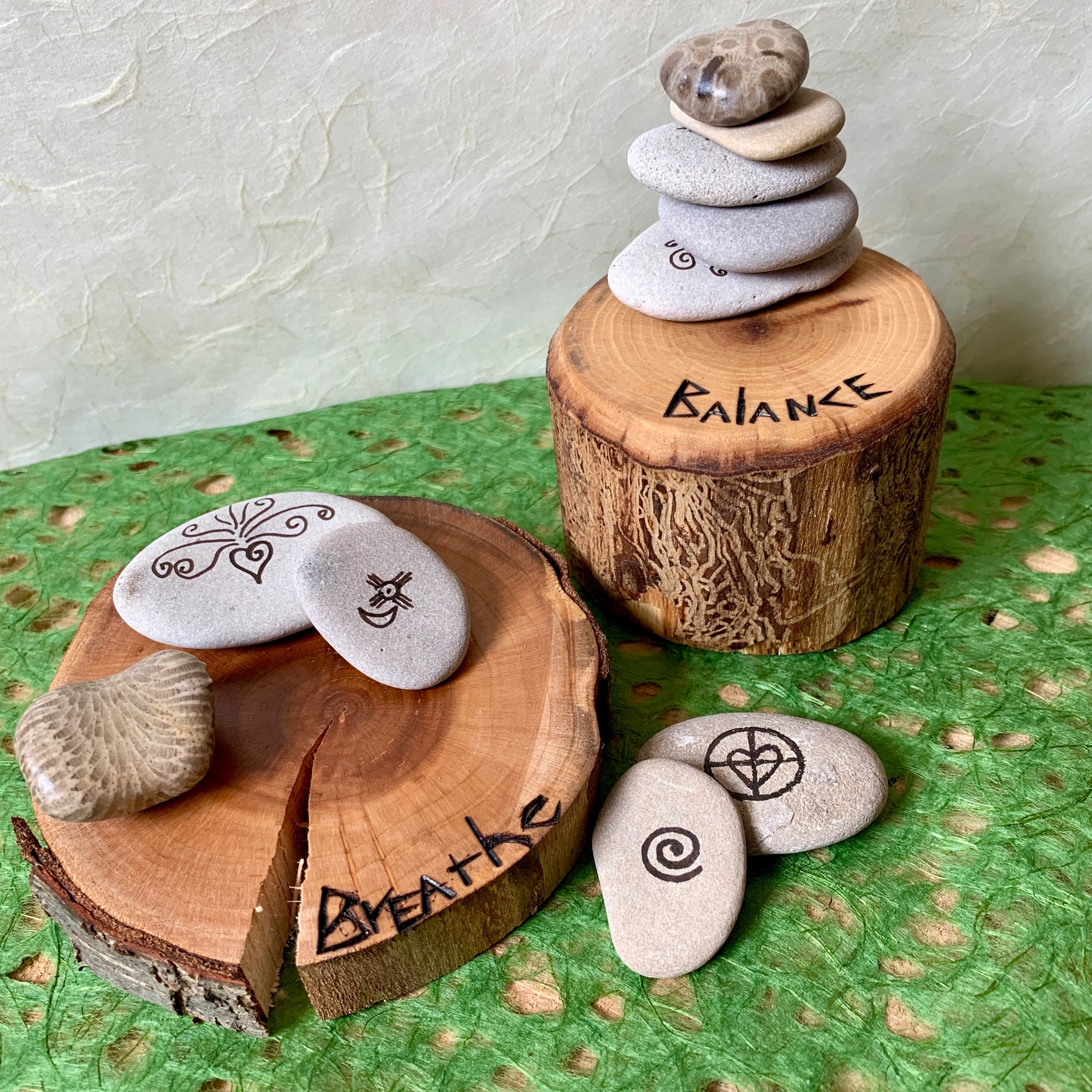 Stone Cairn & Symbologies - Come back to balance as you create your personal Stone Cairn & Wooden Stand. Choose water-worn Great Lakes stones and a tree-gifted base to support them. Explore various cultural symbols and add them to your stones, connecting you to those elements as you stack them. Top your cairn off with a fossil of choice, reflecting the deep history of our earth, infused with encaustic wax. Let your cairn stand tall on the wooden pedestal once you've burned a word of choice on its surface as a visual reminder. Ages AdultA handmade mini-booklet is included to write symbol origins and meanings if desired, as well as the stone cairn story. All materials are provided.Instructor: Lisa JarrellWorkshop fee: $28 per person, minimum 4, maximum 12