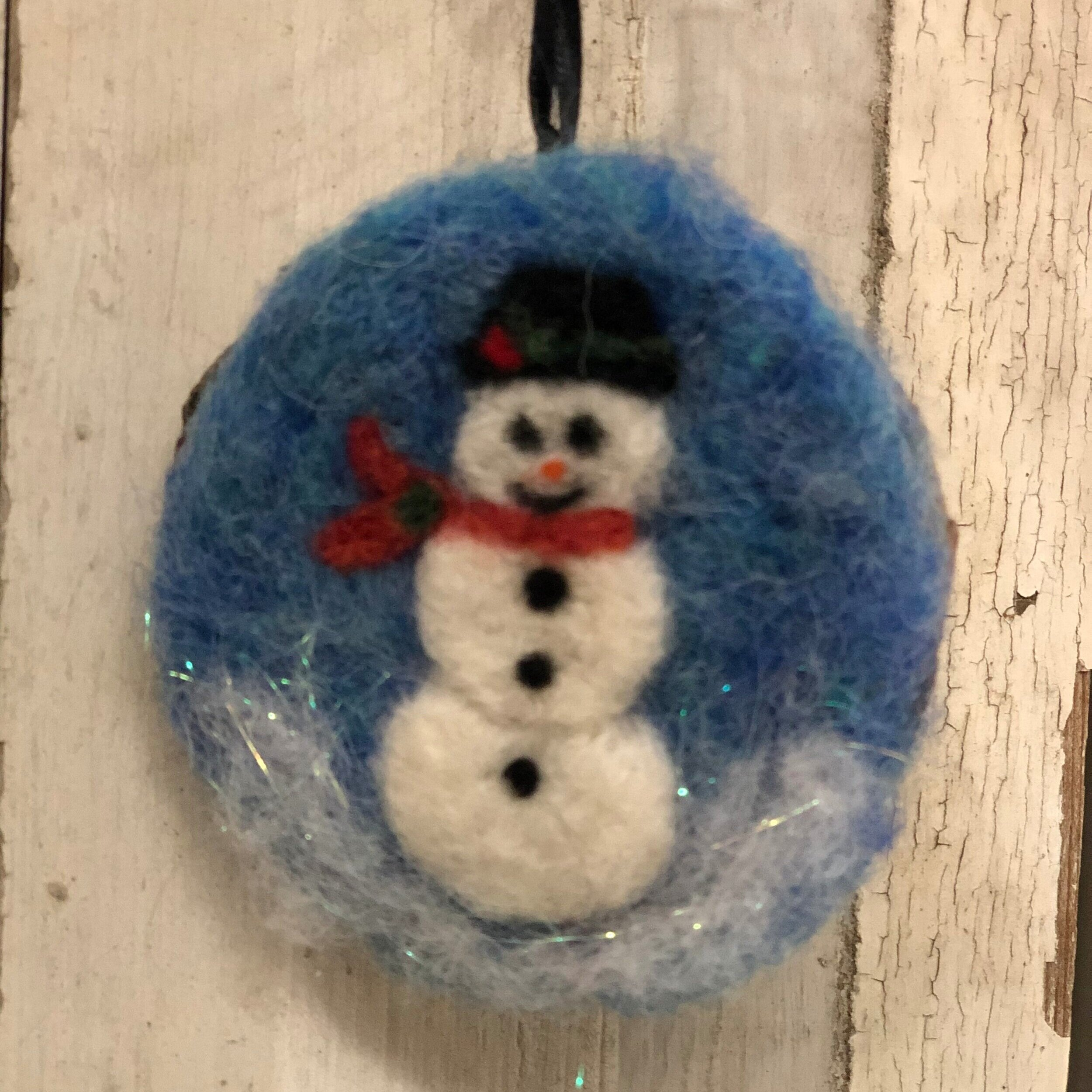 Needle Felted Holiday Ornament - Come and join us for a fun evening making two needle felted ornaments. You will learn to needle felt on a flat piece of felt, a cute fall or Christmas ornament. The finished design is then placed on a wood disk and ready to hang. It's so much fun and best of all, there are no rules! Suitable for beginners and experienced felters. All supplies are included.Instructor: LindaWorkshop Fee: $30, minimum 3, maximum 12